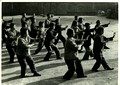 Workers at a textile factory in Tianjin doing shadow boxing (Taiji quan)