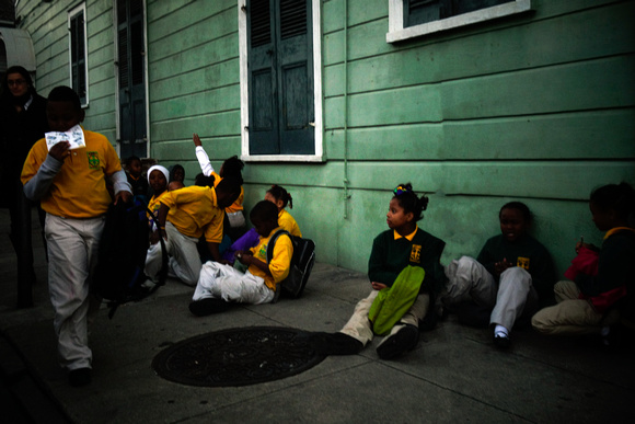 Group of school children, waiting to get picked up