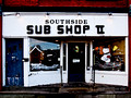 Old storefront, now a Sub shop (with Christmas decorations; Elmira Heights)